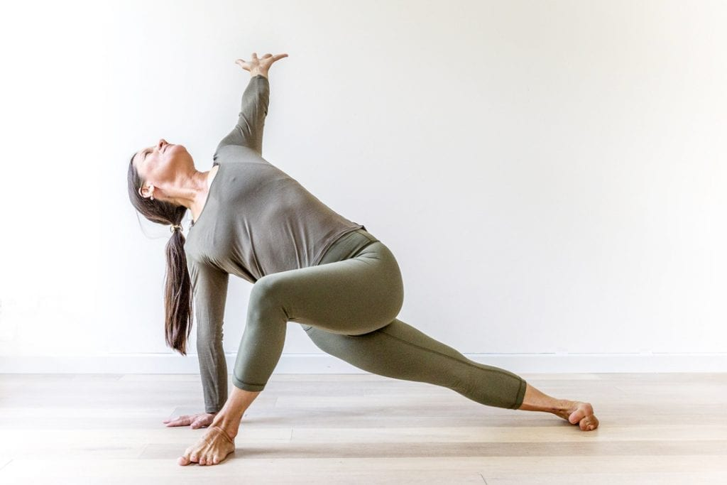 Anoshe Overington in vinyasa pose
